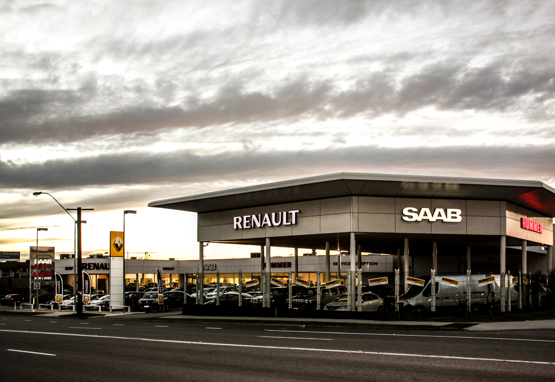car showroom building against cloudy sky
